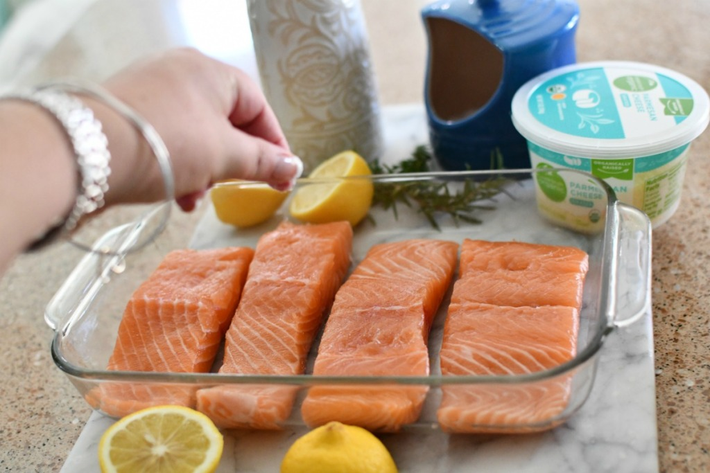 sprinkling salt on salmon before cooking