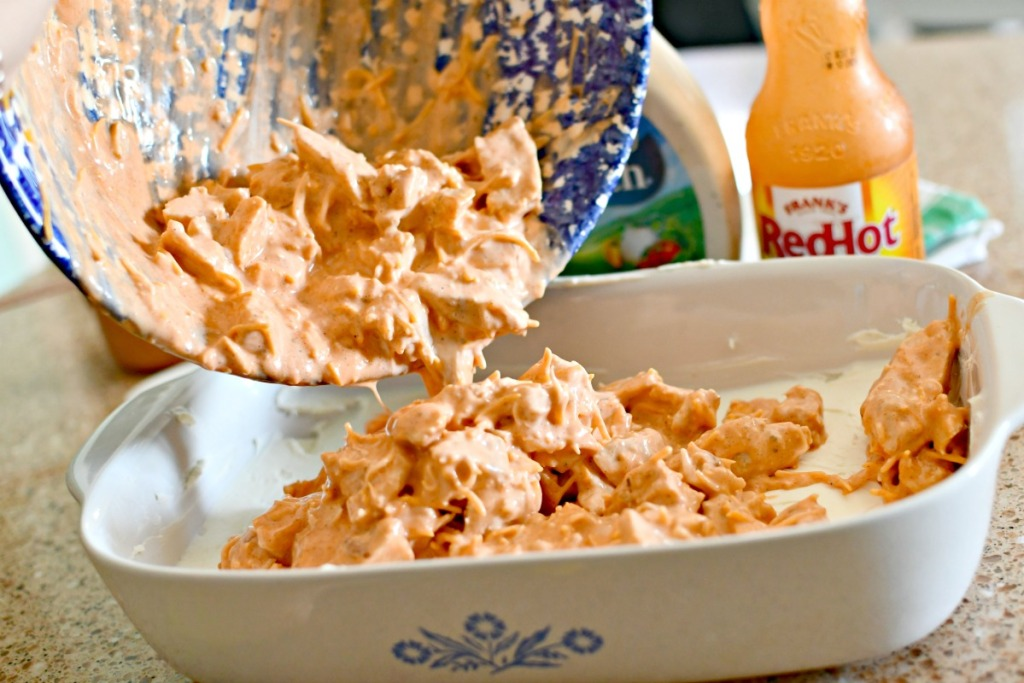 pouring dip into casserole dish