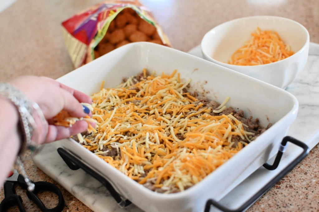 adding cheese to tater tot casserole before the tots