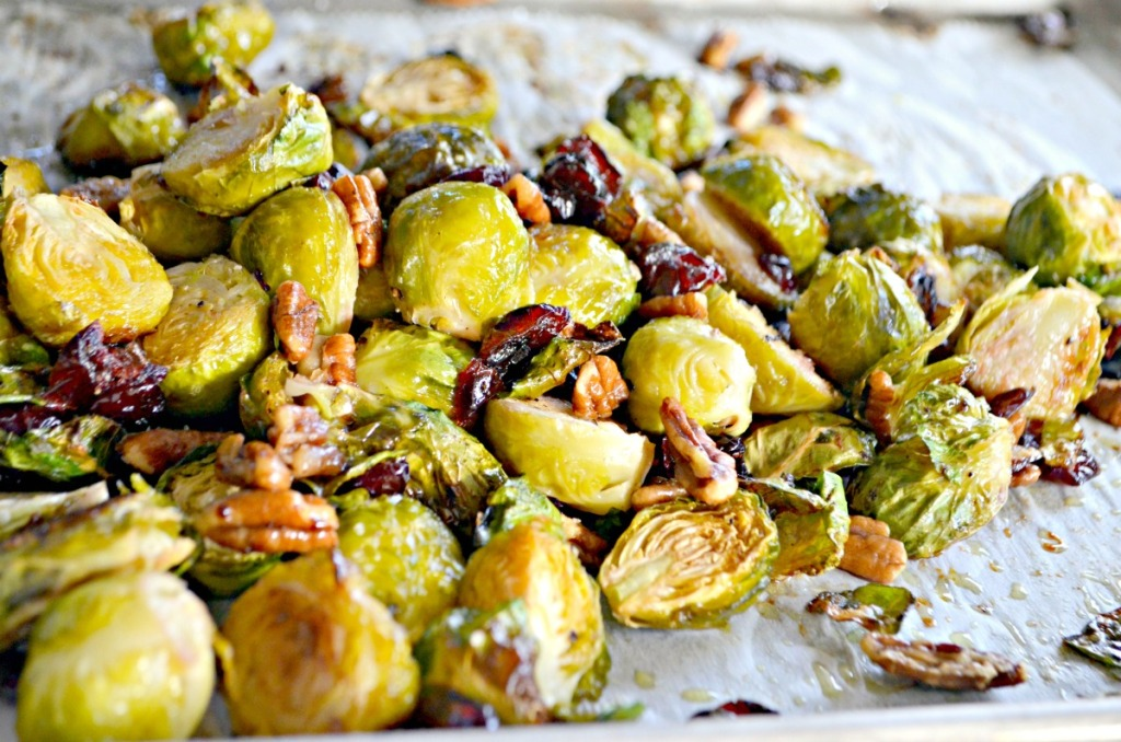 cranberry brussels sprouts on a sheet pan