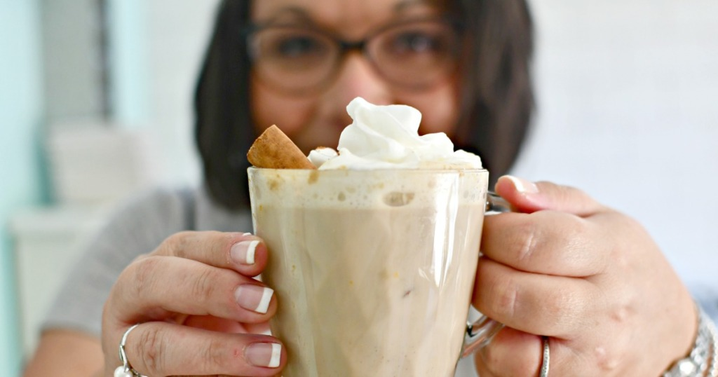 holding a cup of pumpkin spiced latte from the slow cooker