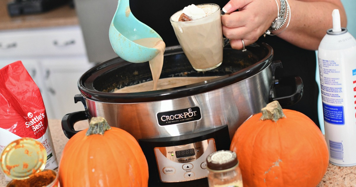 pouring a cup of slow cooker pumpkin latte