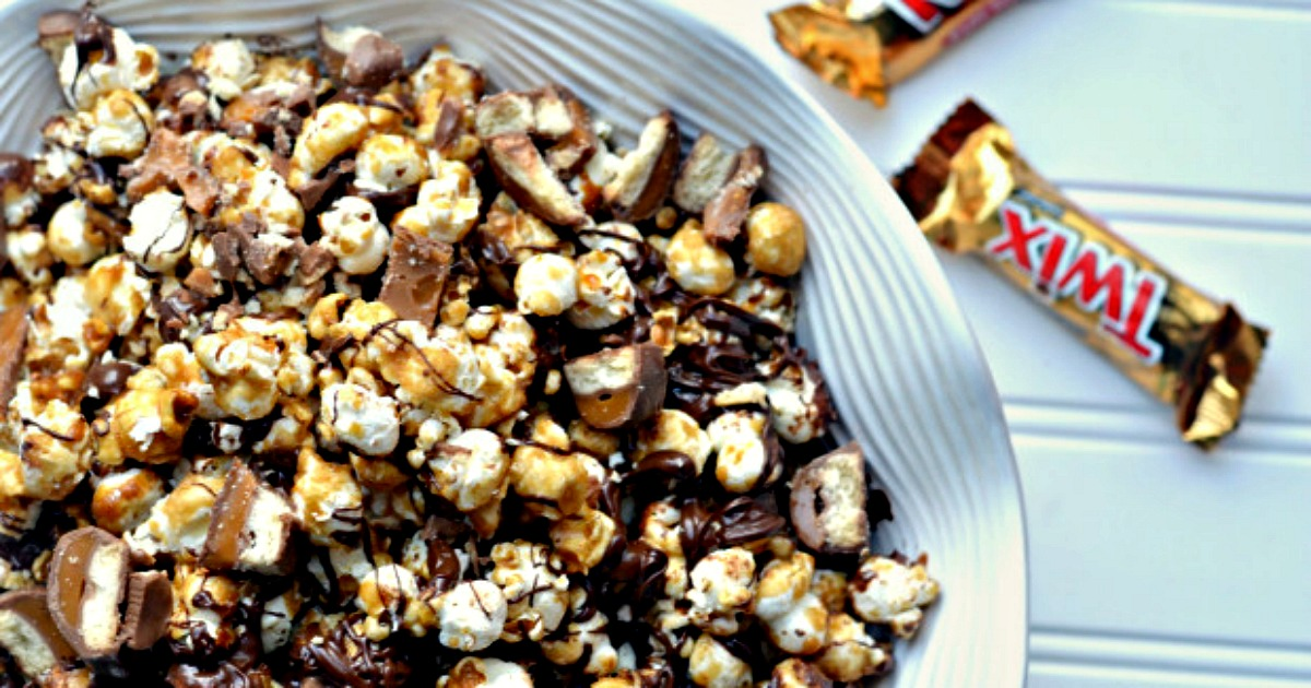 twix caramel popcorn recipe – in a serving bowl next to Twin candy bars