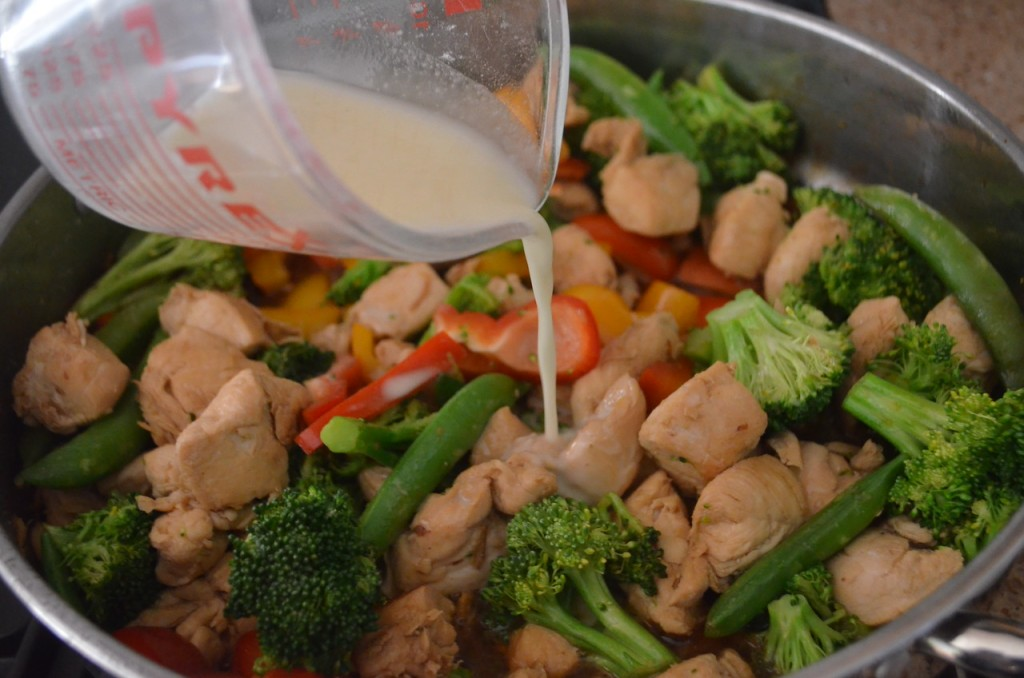 Pouring Sauce over Chicken Stir Fry