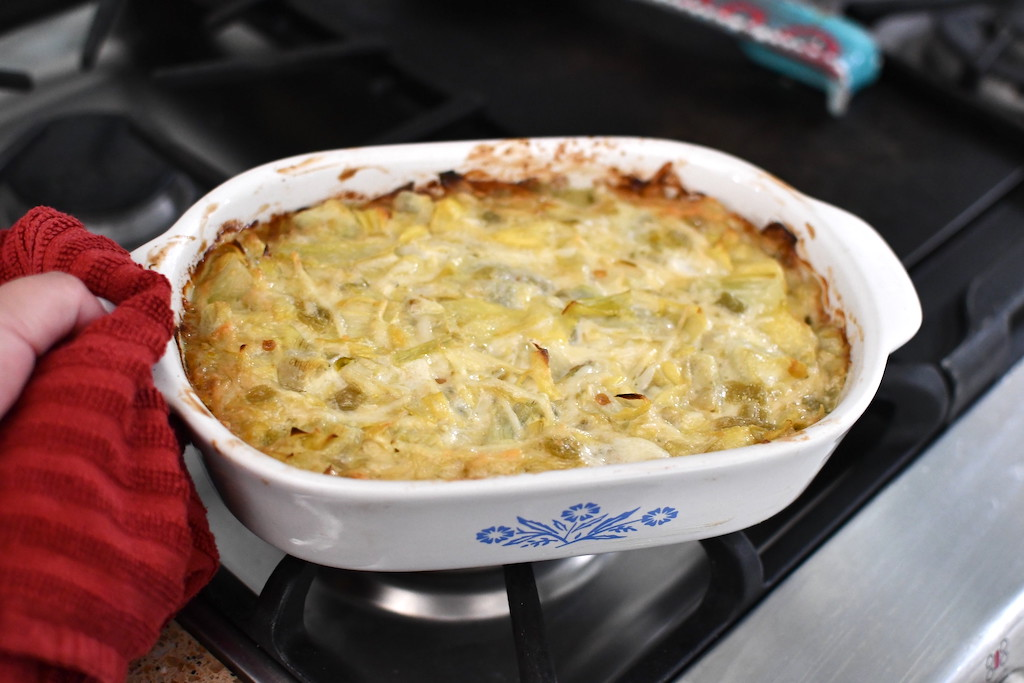 baked artichoke dip on top of oven