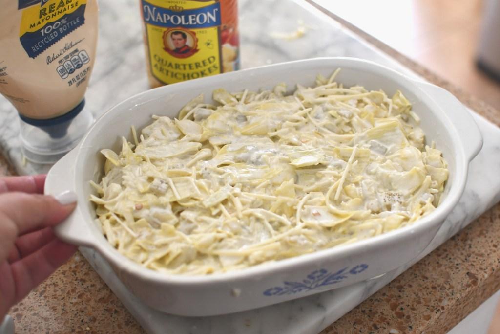 casserole dish with artichoke dip