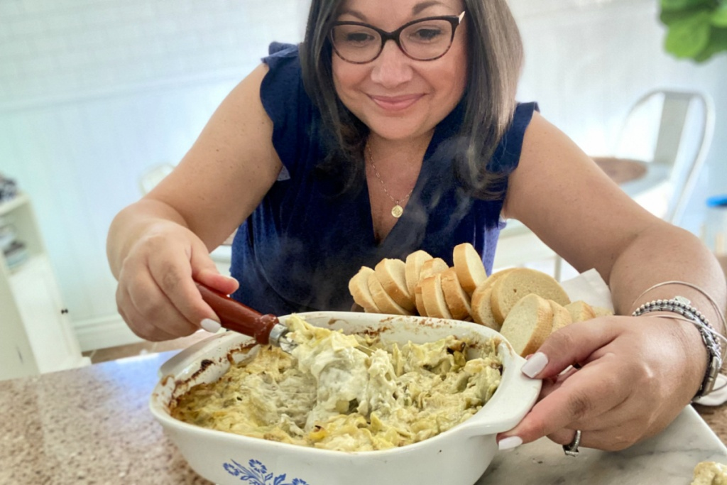 woman with artichoke cheese dip