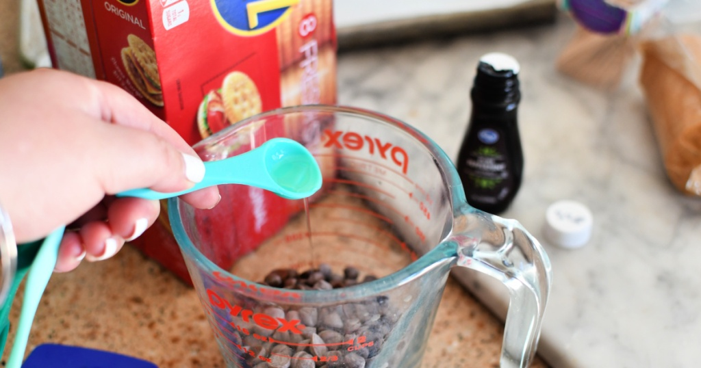 adding mint extract and oil to chocolate chips for thin mint cookies