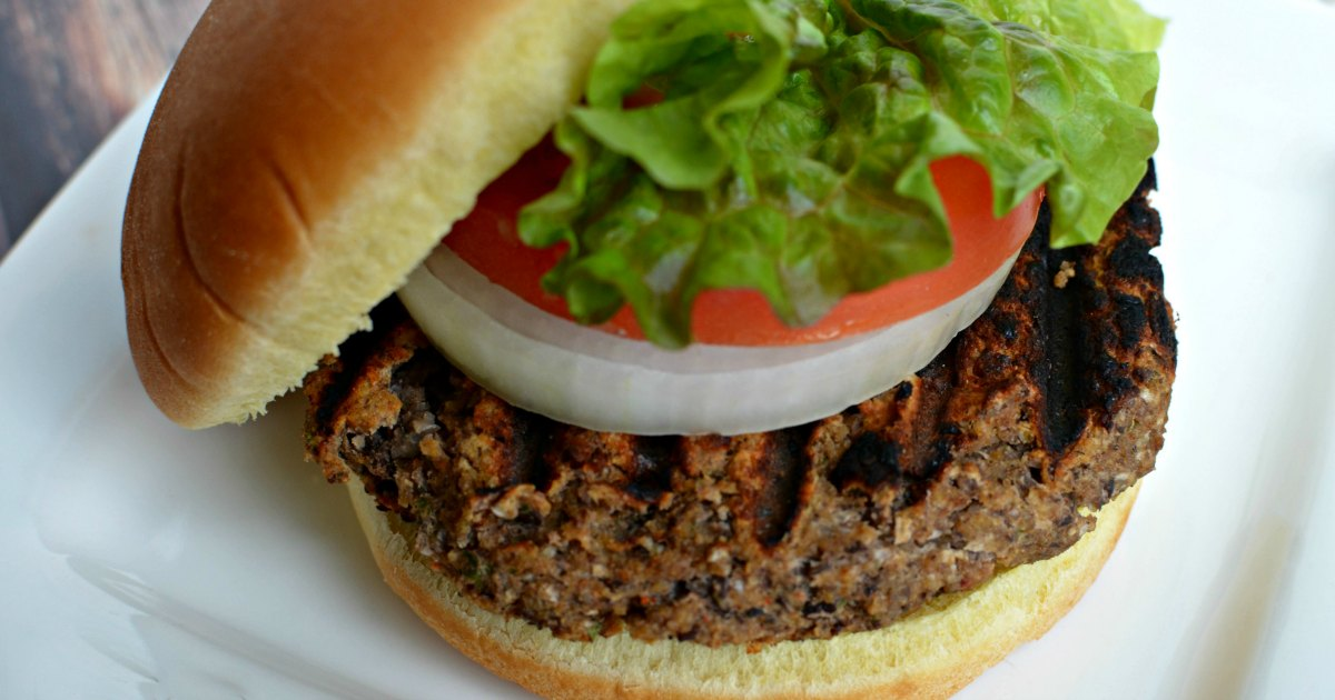 chilis inspired black bean burgers – on a bun with lettuce, tomato, and onion