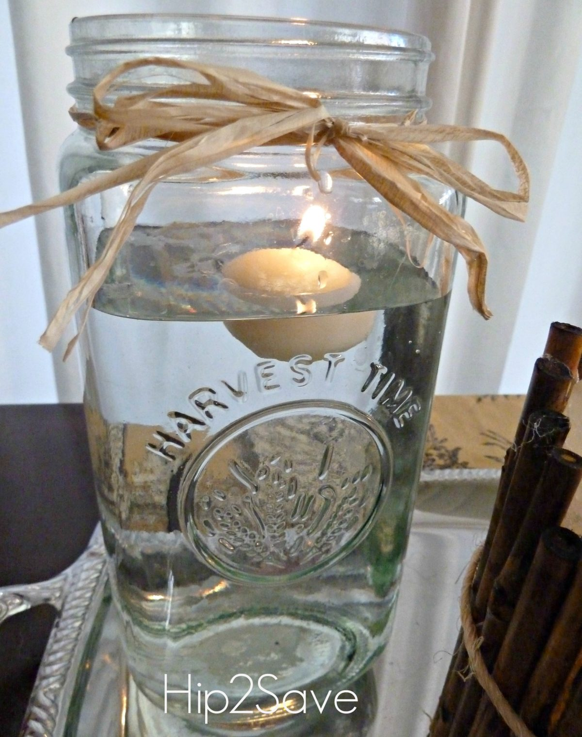 Mason jar with floating candle