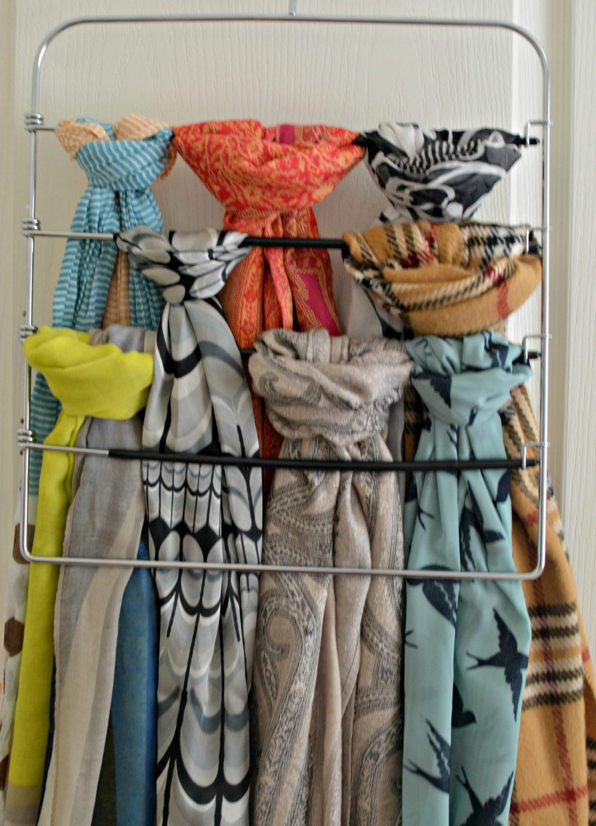Use a pant hanger to organize scarves Hip2Save