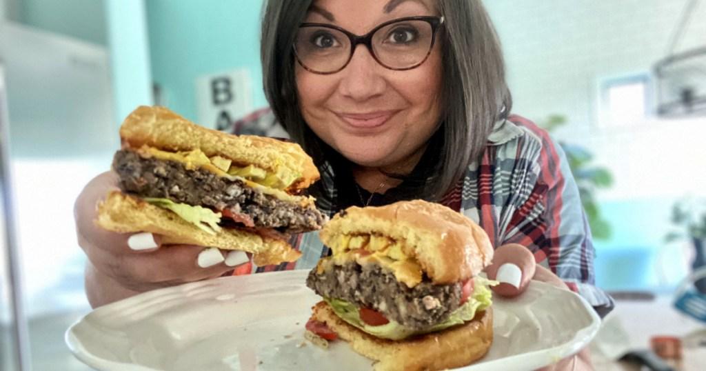 woman holding a black bean burger