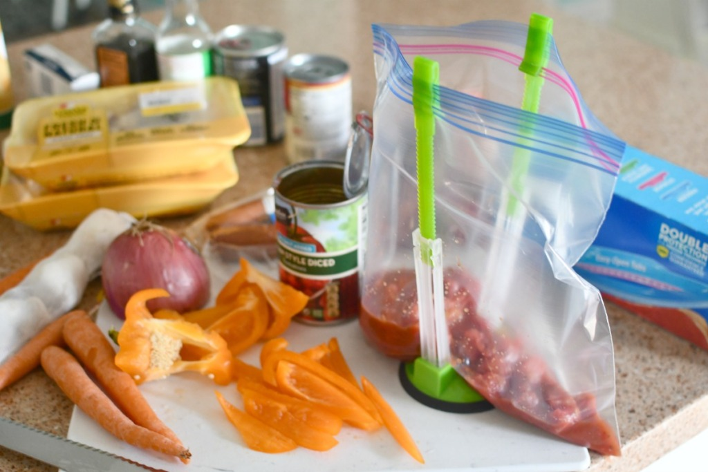 compiling freezer meals on the counter