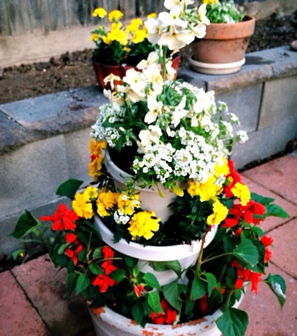 vibrant flowers in tiered planter