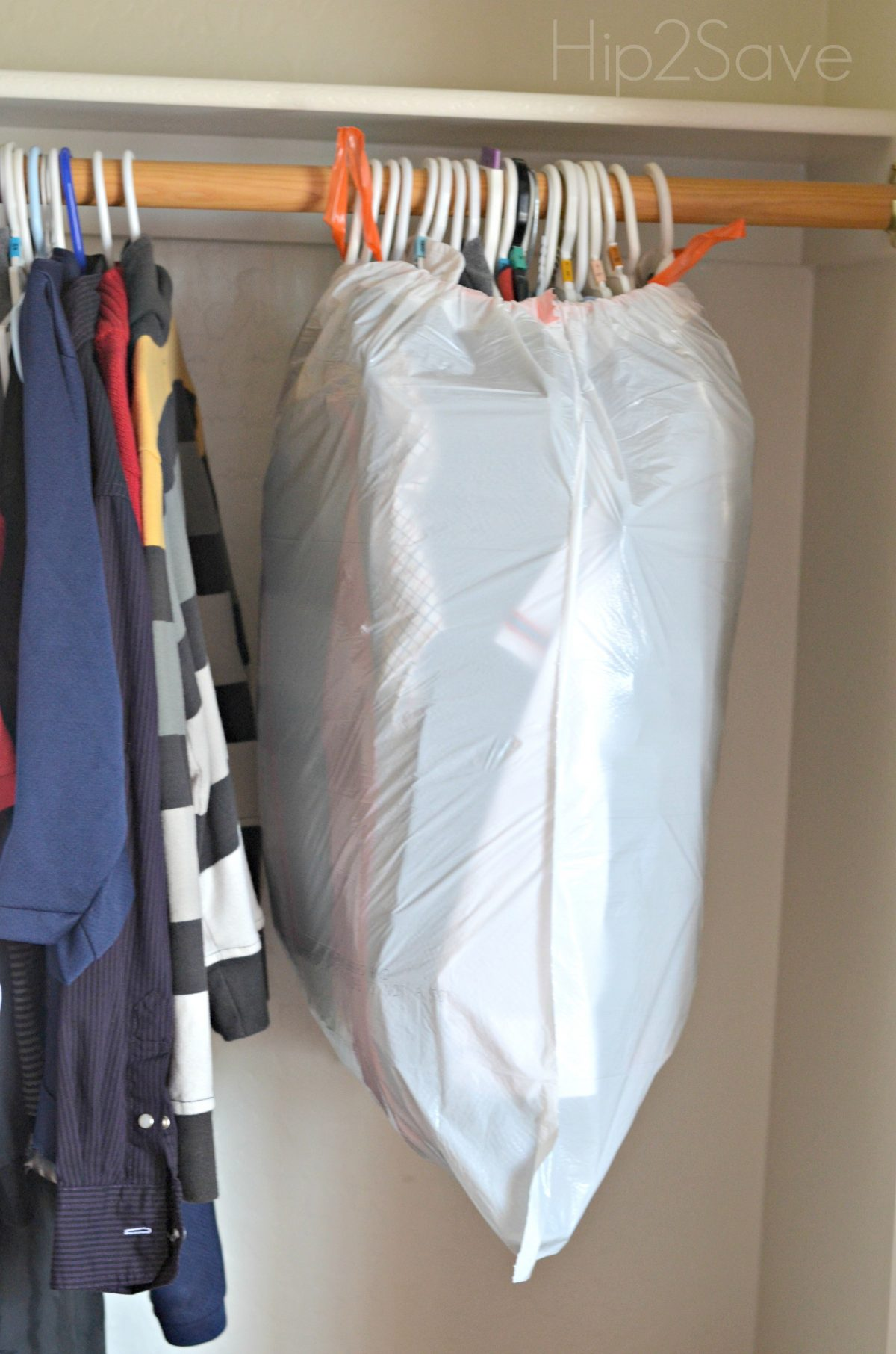 Use a garbage bag for hanging clothes Hip2Save