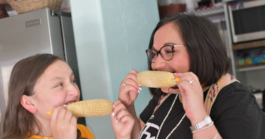 eating corn in the kitchen