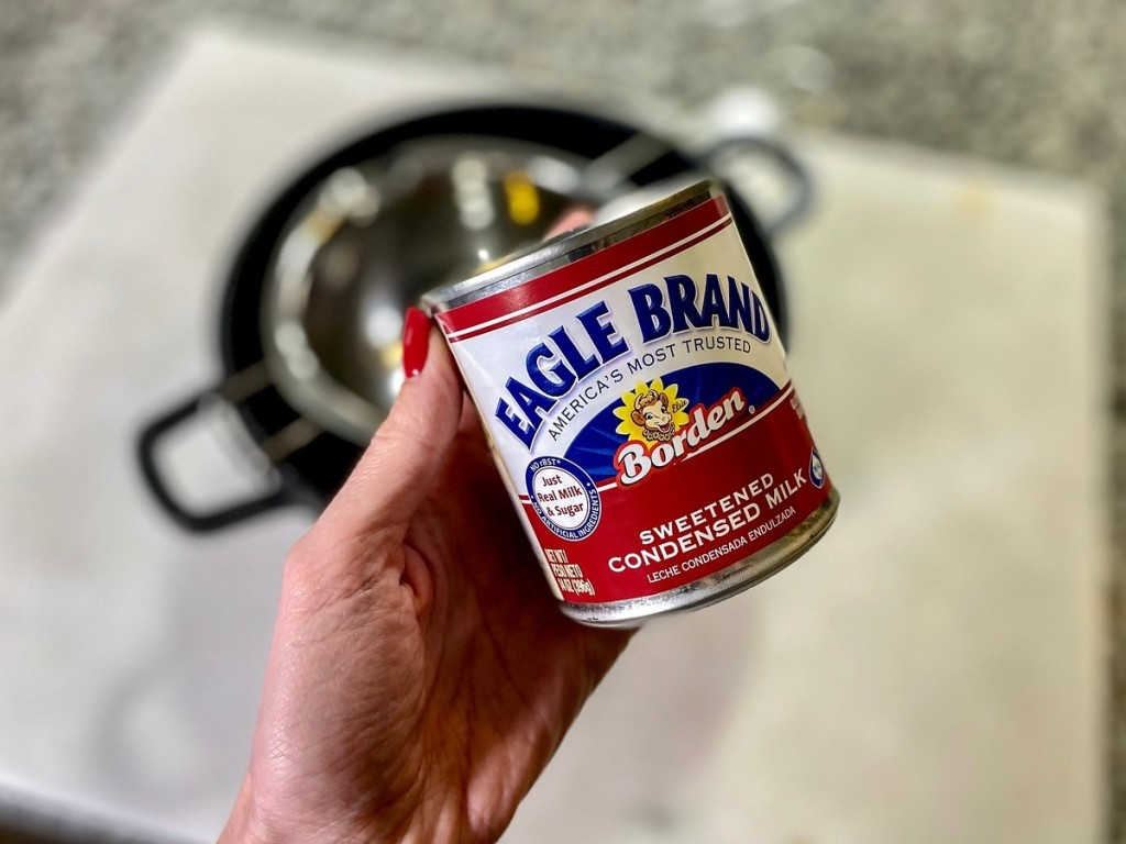 hand holding can of Eagle Brand condensed milk