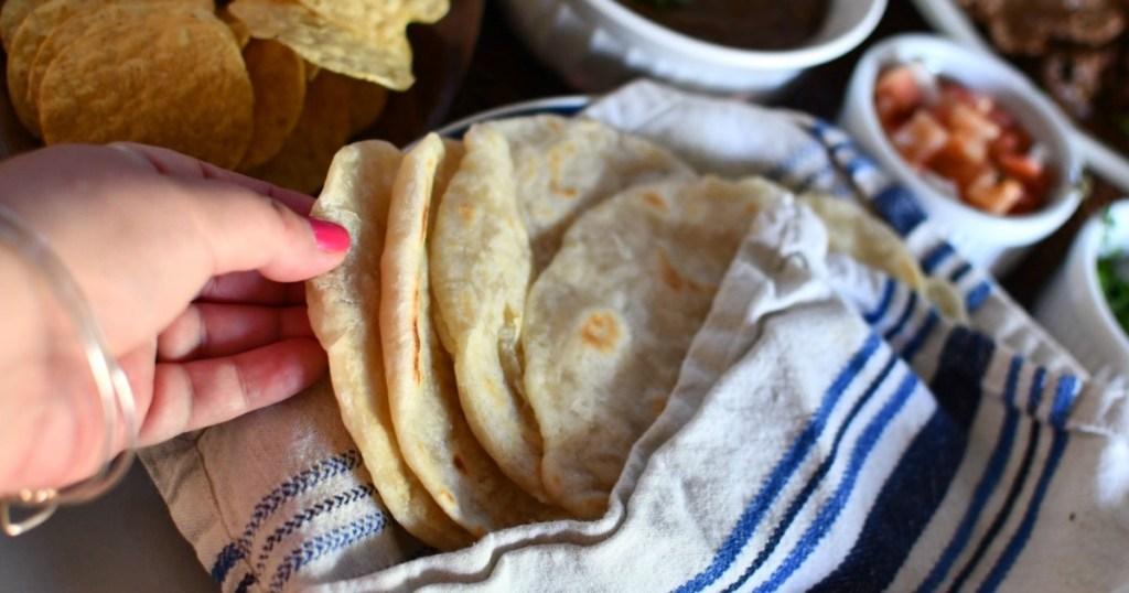 picking up homemade flour tortilla