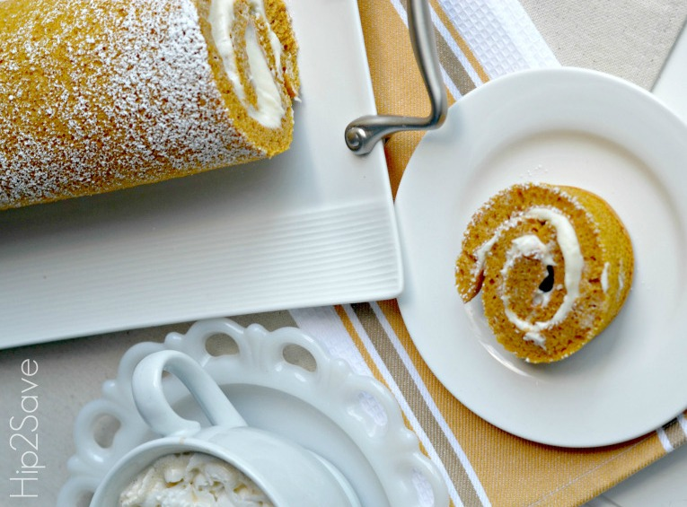 pumpkin roll with cream cheese frosting recipe rolled up and sliced for serving