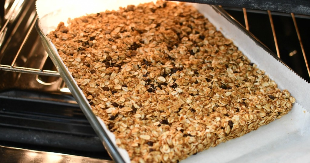 putting granola bars into the oven