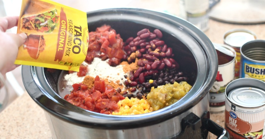 adding taco seasoning to slow cooker taco soup