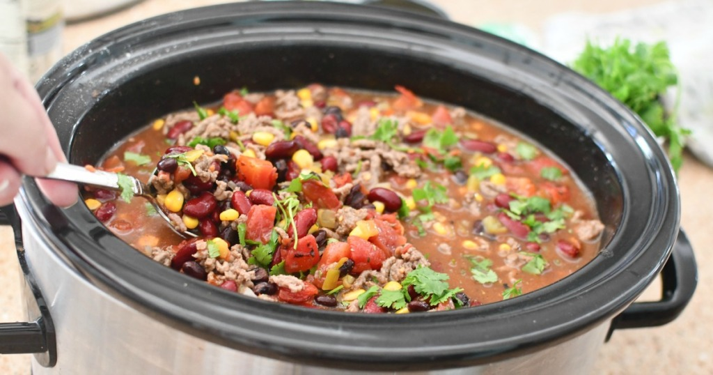 stirring taco ranch soup in slow cooker