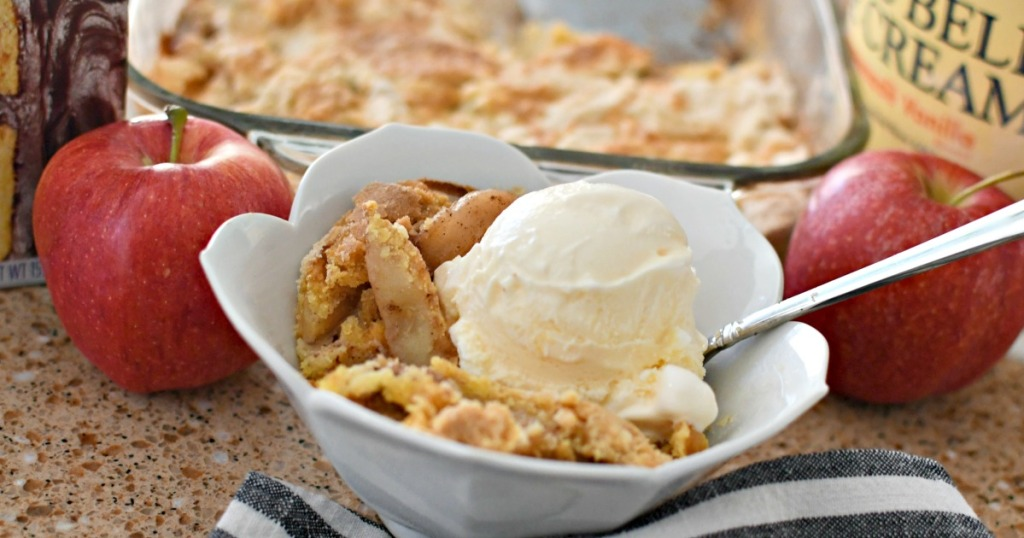 bowl of apple dump cake with vanilla ice cream
