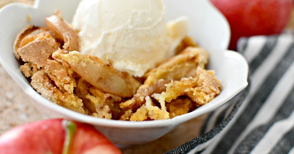 bowl with apple dump cake and ice cream