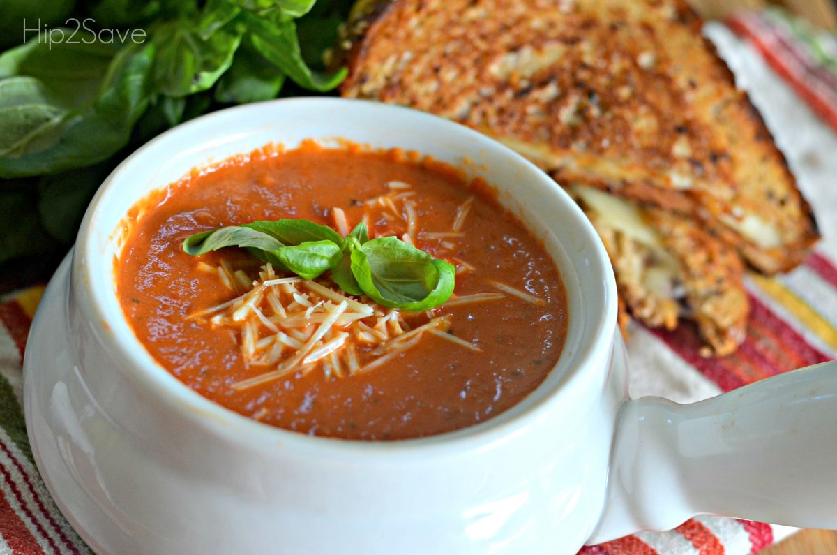 Easy tomato soup recipe in a bowl next to a sandwich