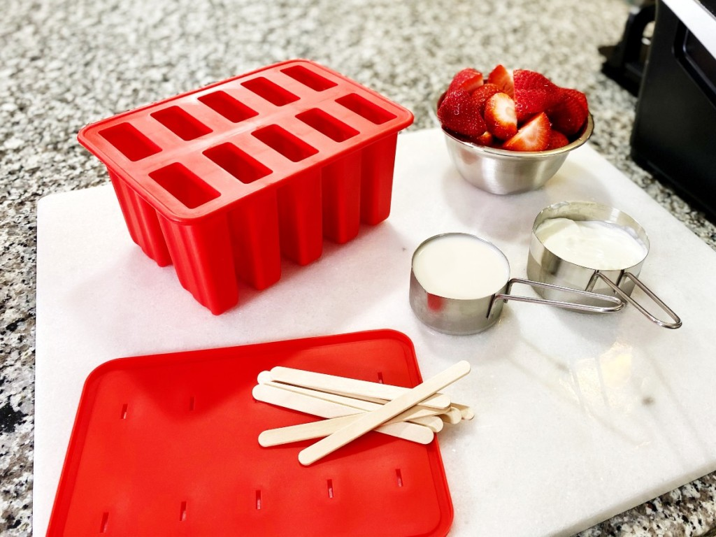 strawberry popsicle ingredients on counter