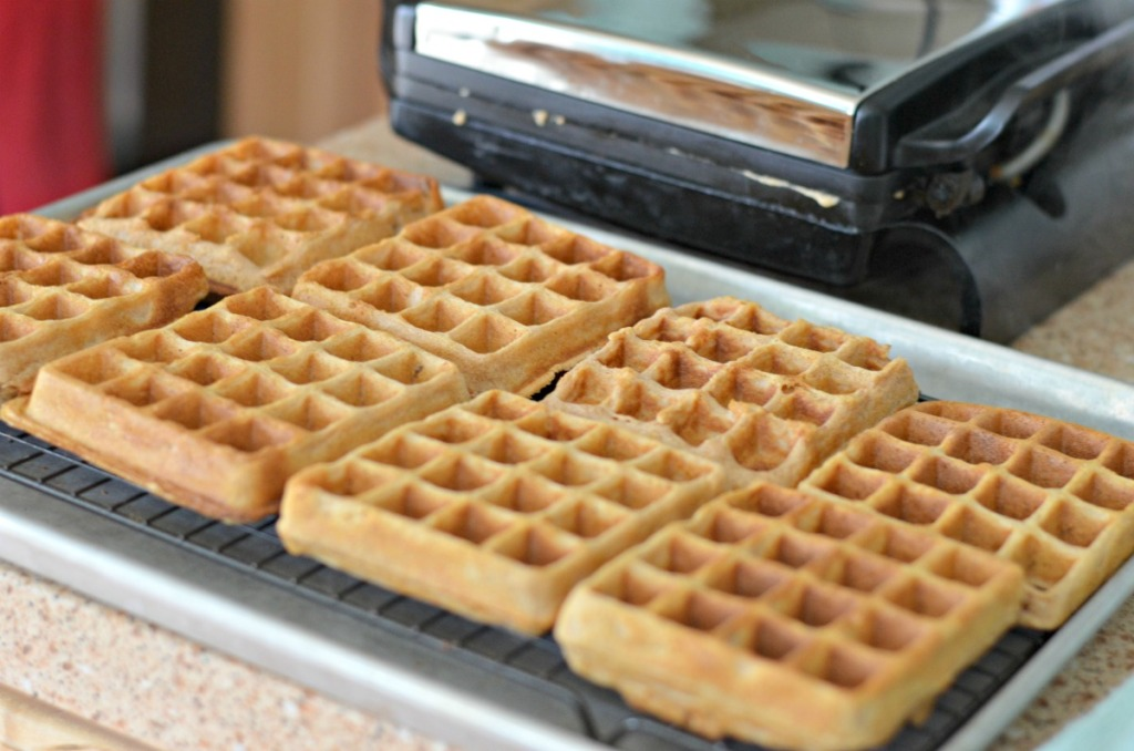 making homemade waffles in a waffle iron