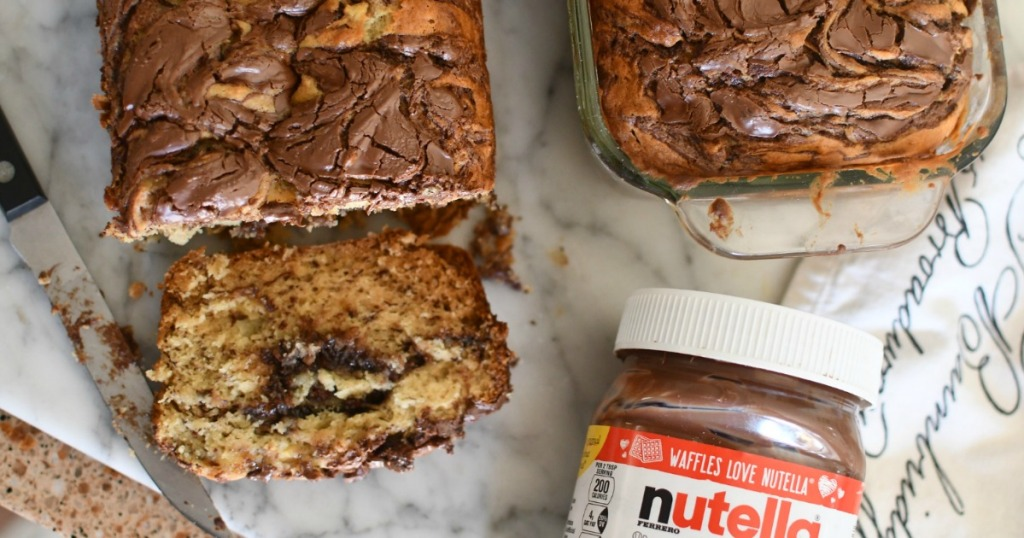 sliced banana bread with nutella on cutting board