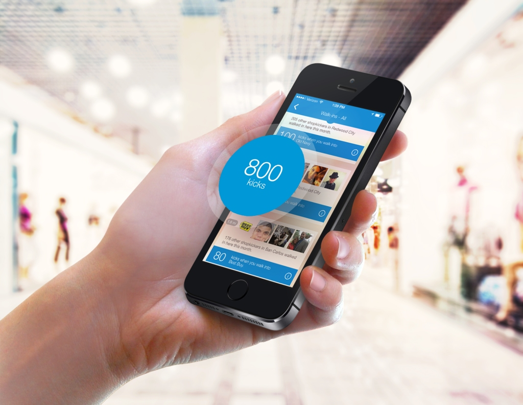 hand holding up phone showing shopkick app