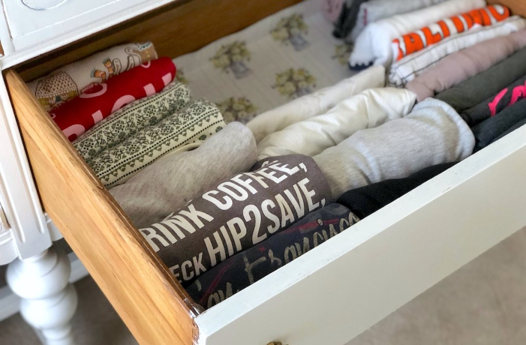 organized dresser clothing drawer with various clothes