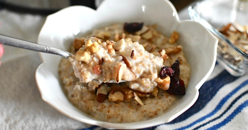 overnight steel cut oats in bowl with nuts and dried fruit