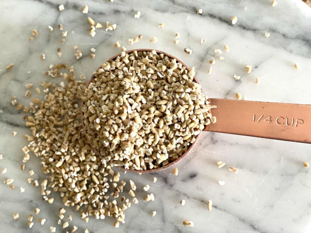 raw steel cut oats in a measuring cup