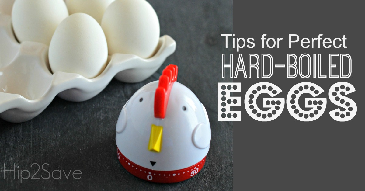Hard-boiled Eggs next to a chicken egg timer