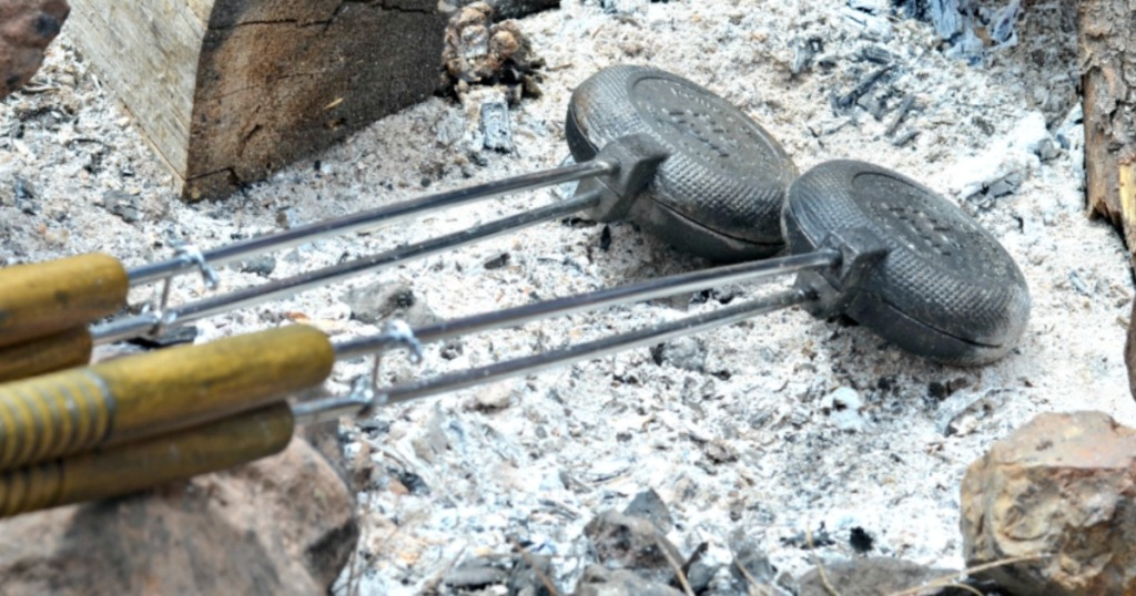 set of pie irons in the campfire