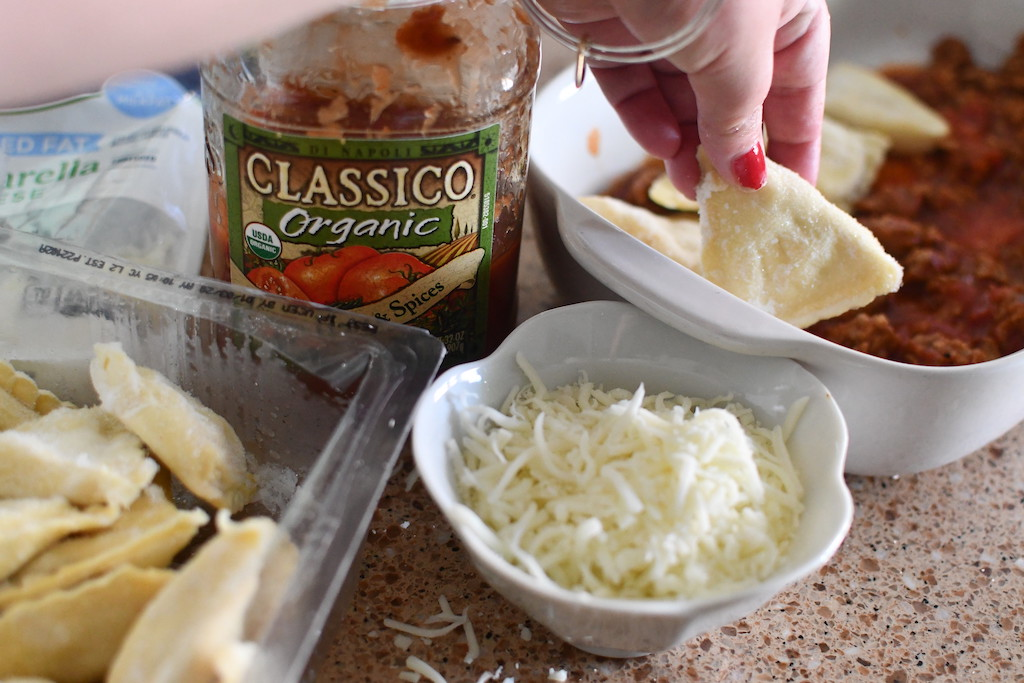 Classico pasta sauce jar by shredded cheese and frozen raviolis