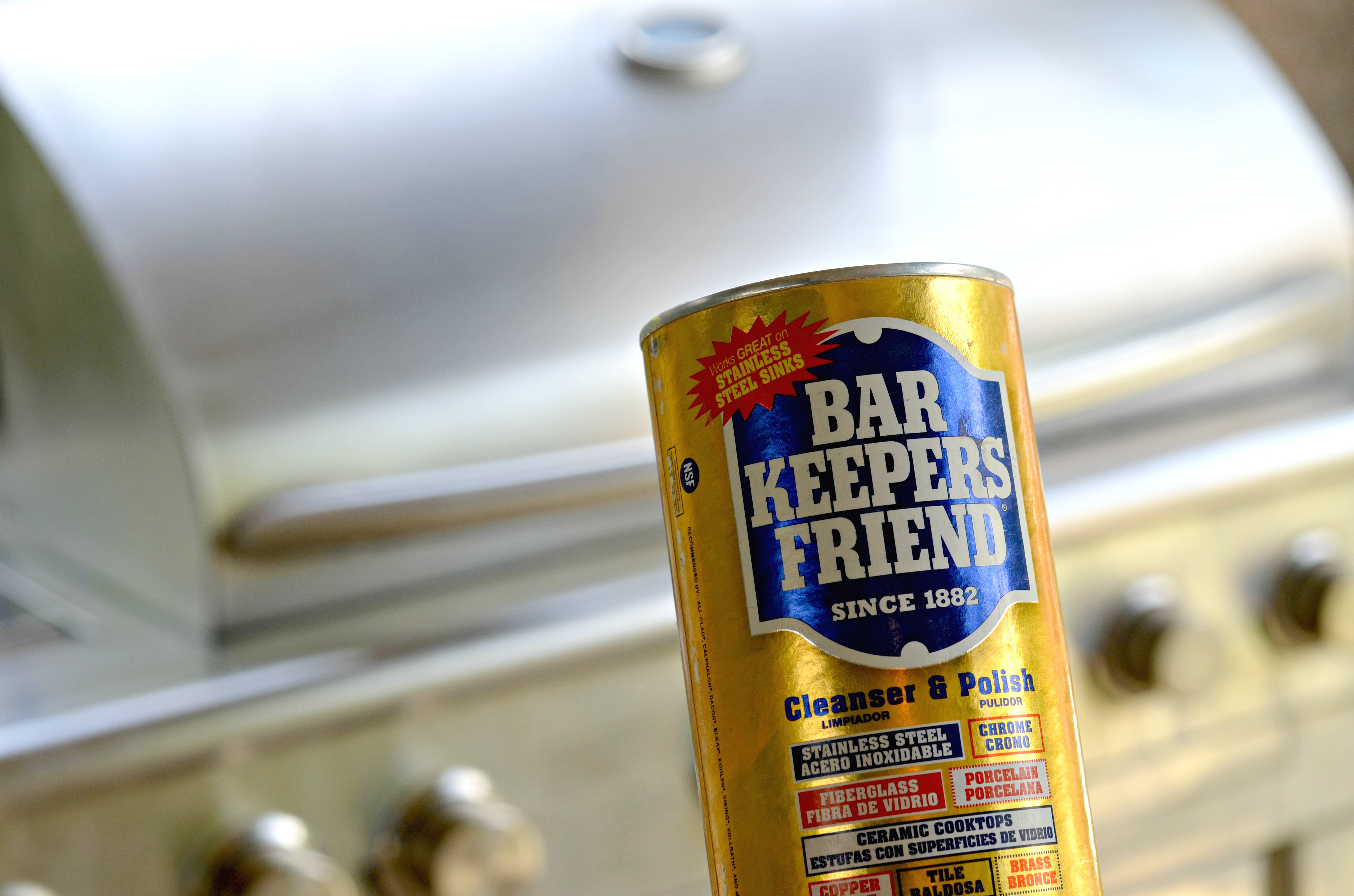 Bar Keepers Friend in front of a barbecue grill