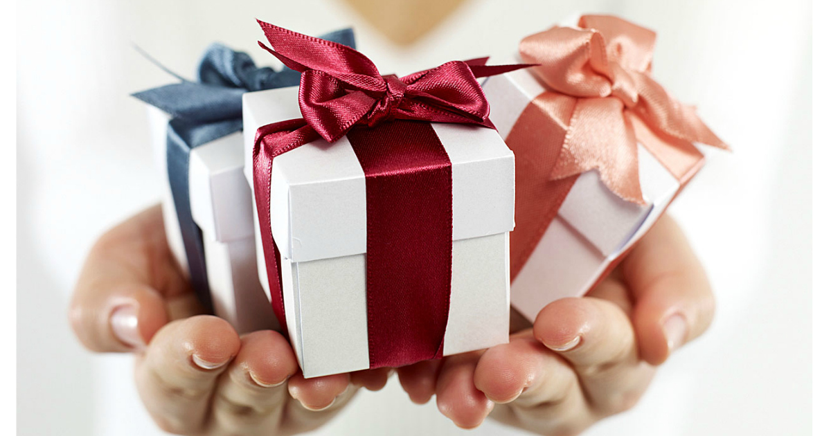 tiny Wedding Gifts in the palm of someone's hand