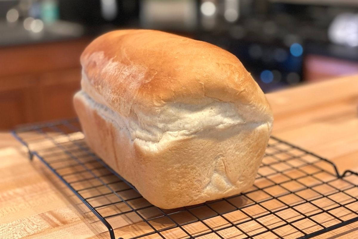 A loaf of bread on a baking rack
