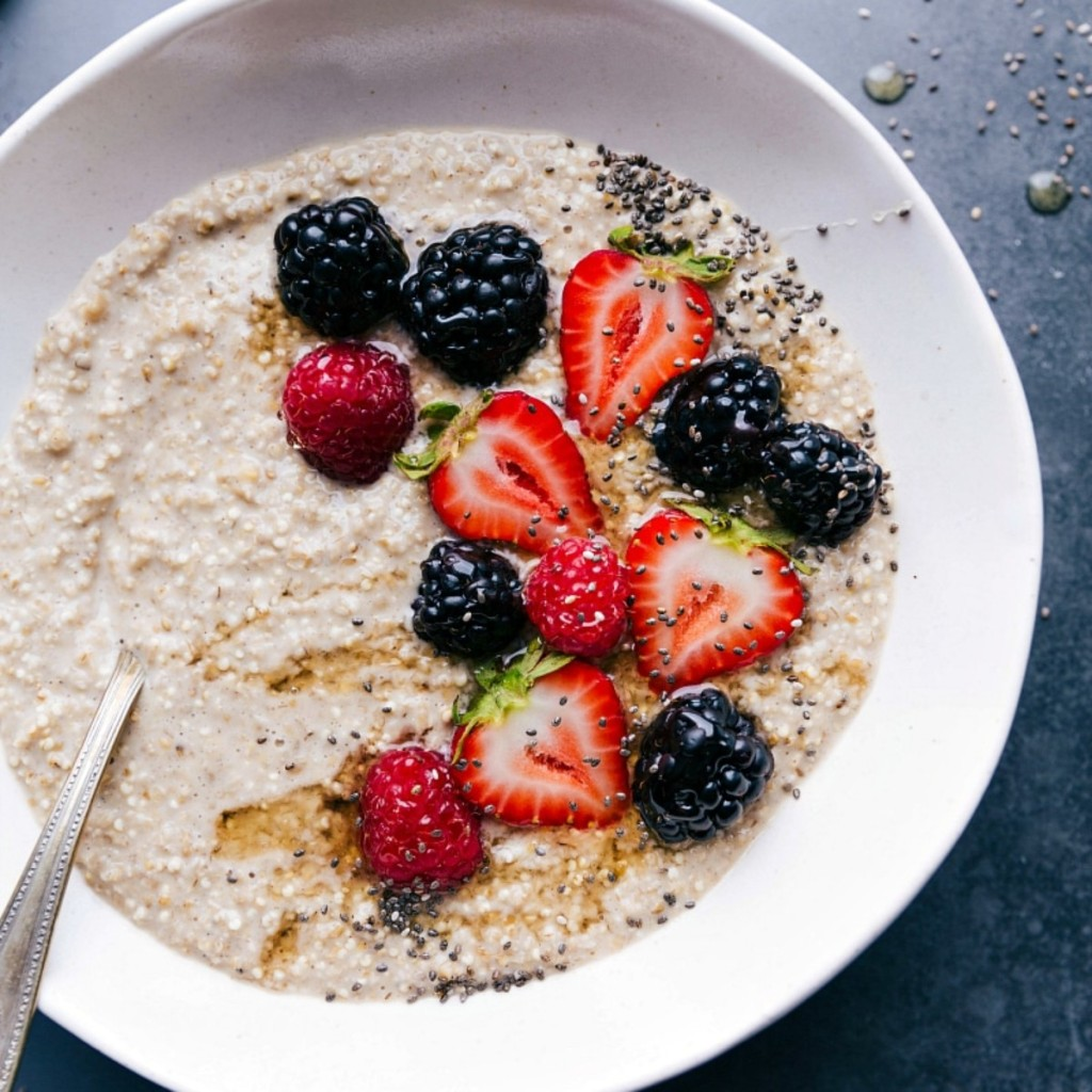 oatmeal with berries in white bowl
