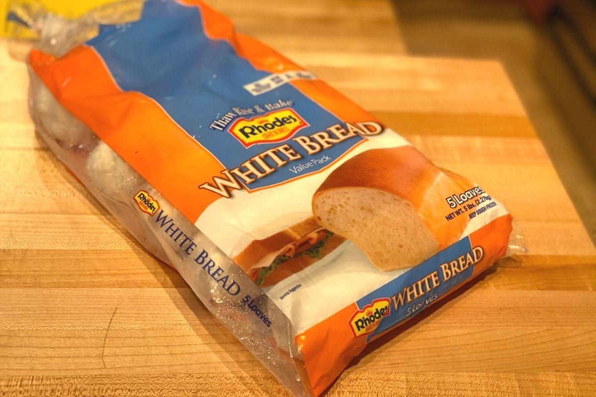 A bag of white frozen bread dough on a table