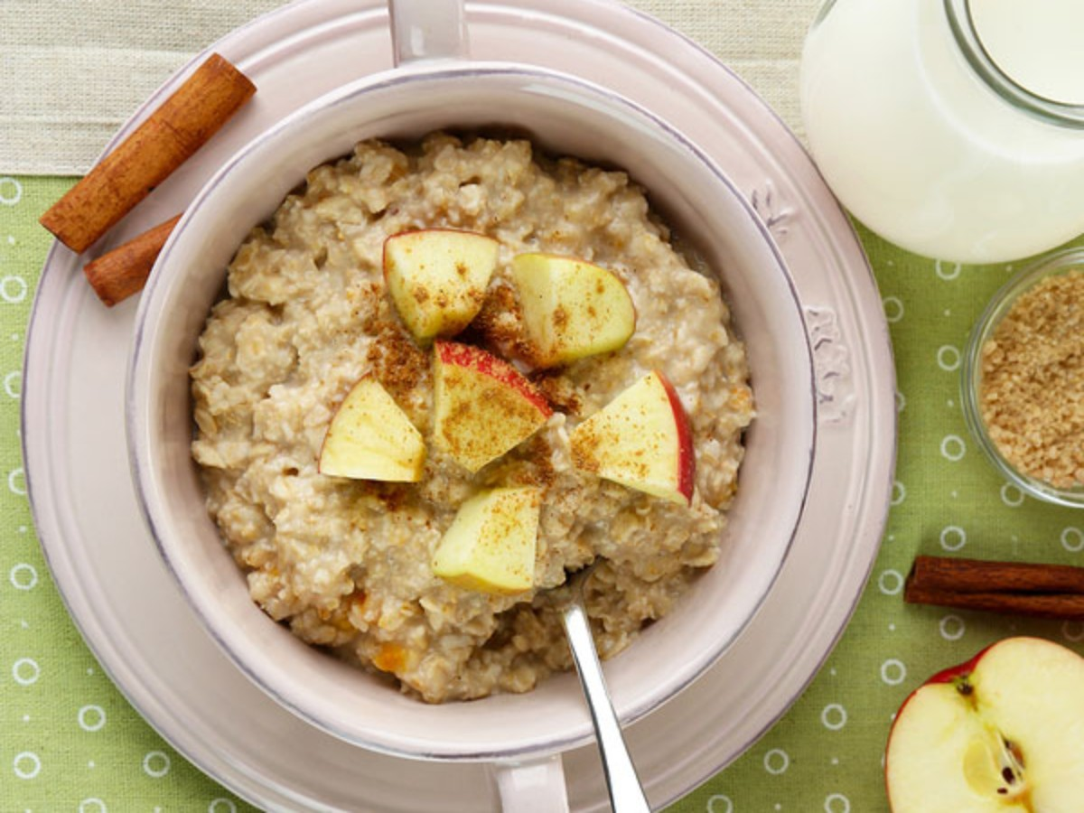 oatmeal in bowl topped with apples and cinnamon