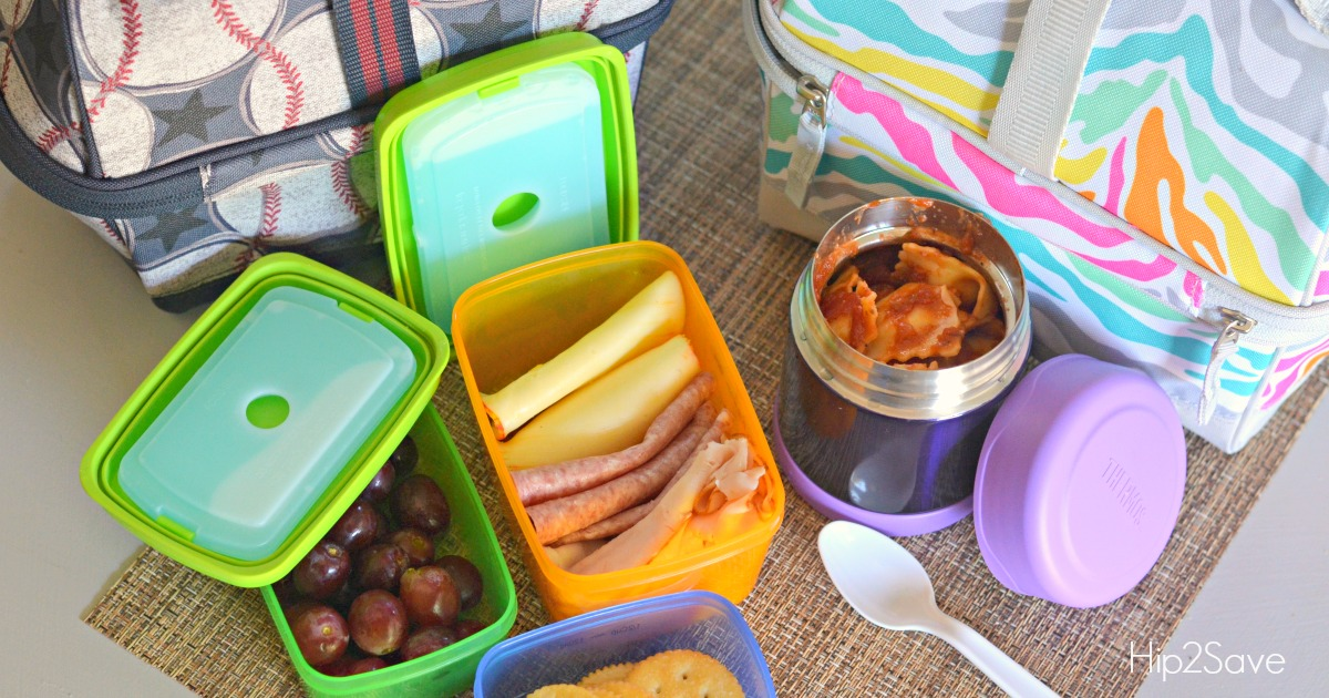 lunch containers and lunchboxes on a table