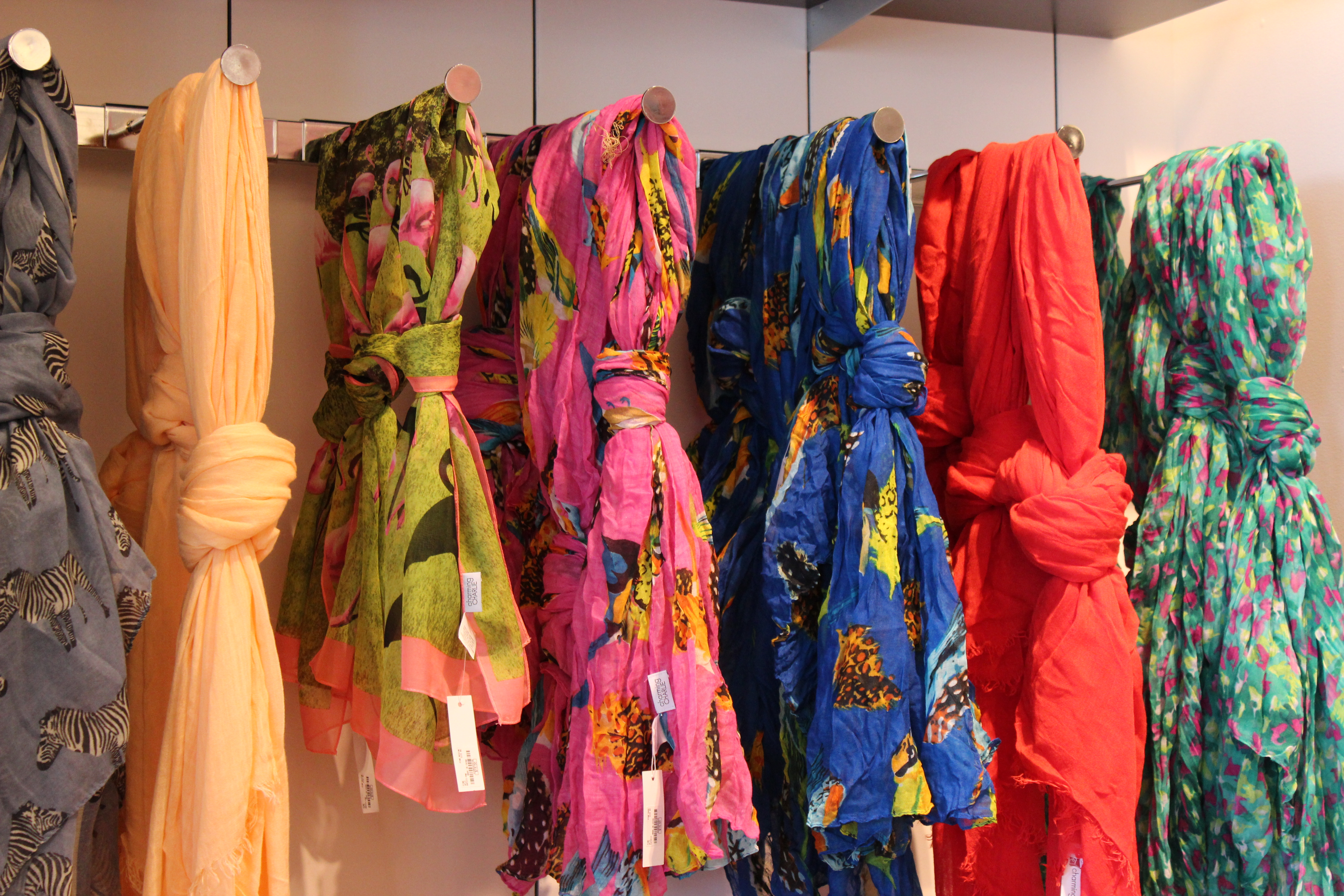 Get a FREE $5 Charming Charlie Voucher to Spend In-Store During Your Birthday Month - scarves display