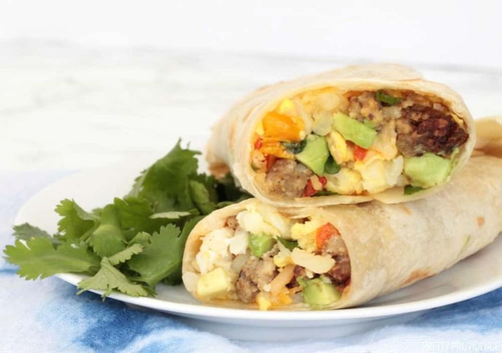 breakfast burrito on plate with cilantro