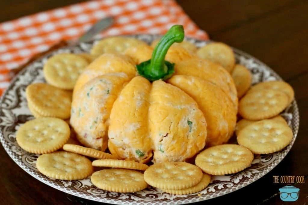 Easy-Pumpkin-Shaped-Cheeseball-on-a-serving-plate