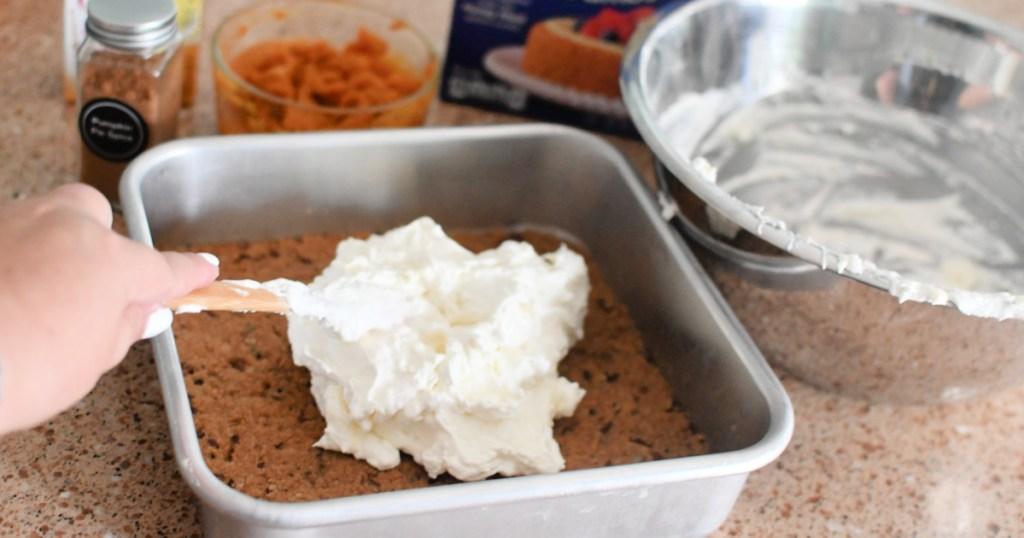 adding cream cheese layer to pumpkin delight